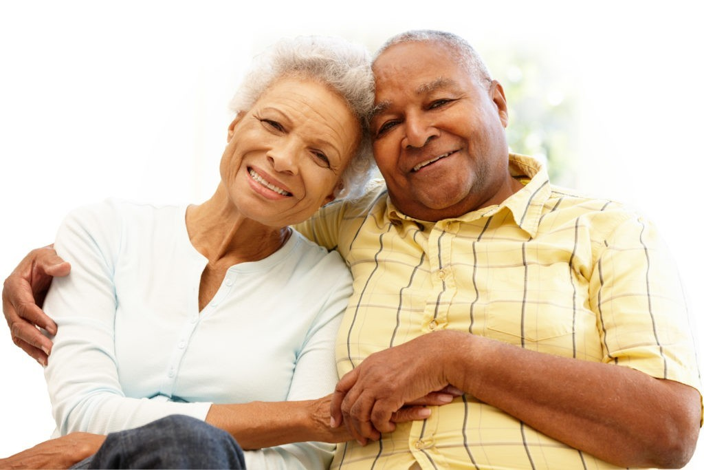 Senior African American couple at home, holding hands